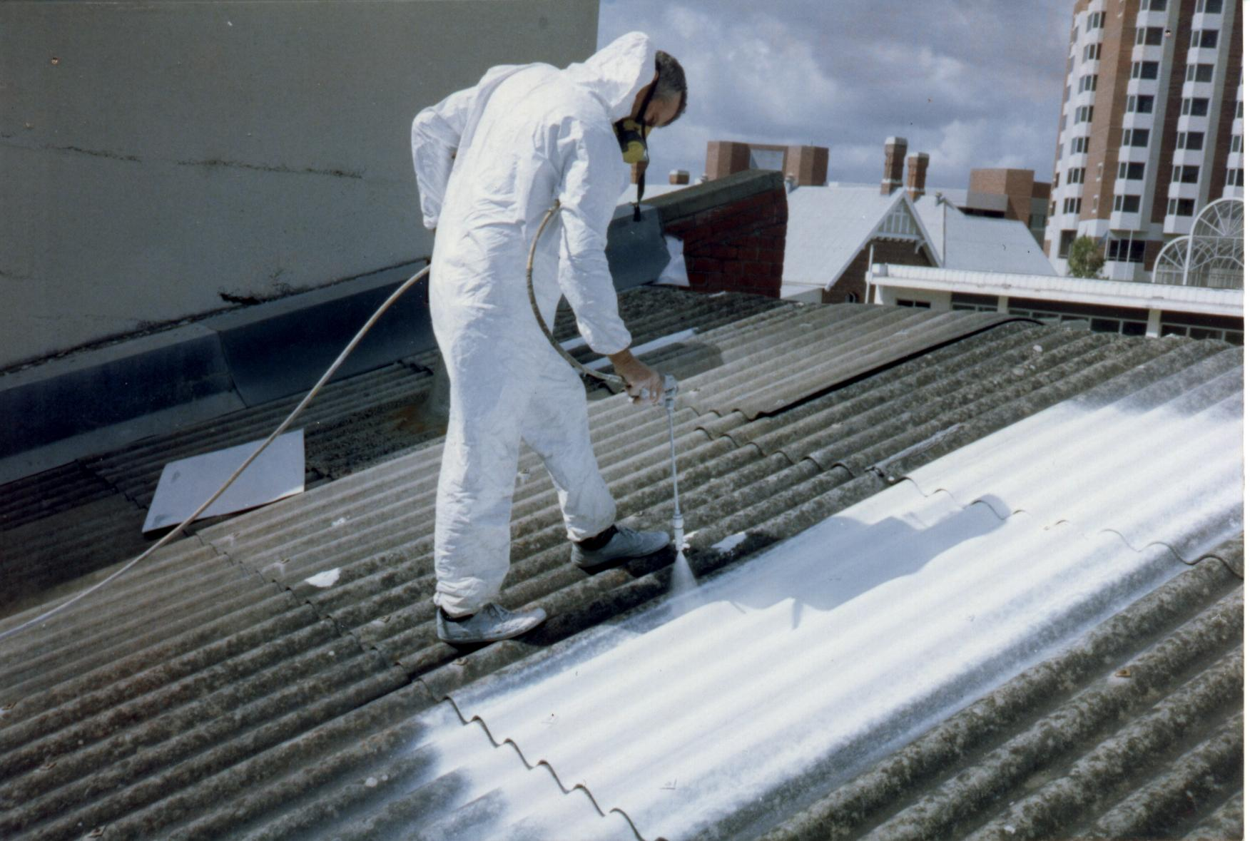 Asbestos roof spraying