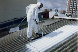 Asbestos roof spraying