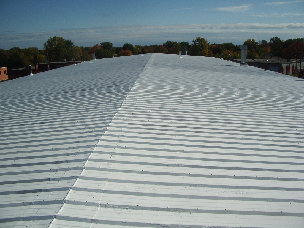 Elastomeric roof coating metal roof