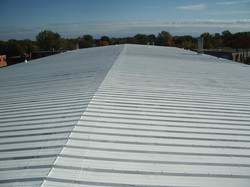 Elastomeric roof coating metal roof