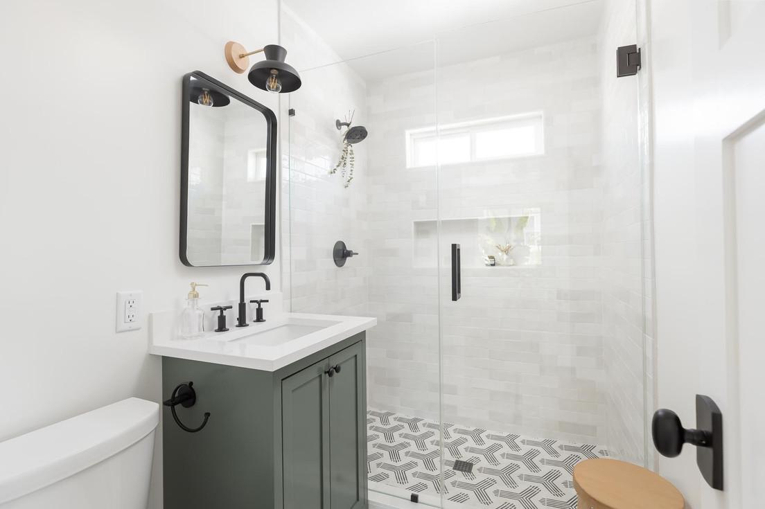 ADU-Bathroom-Gray-Vanity-Black-Fixtures-Tiled-Shower-1.jpg