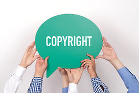 Group of people holding the COPYRIGHT wr