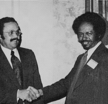 Robert Nash, AIA vice president, right, presents a first Honor Award to Leonard G. Gordon, associate in the San Francisco firm of Bulkey and Sazevich. Rev. E. LeRoy Evans, minister of First Friendship Institutional Church, which sponsored the Friendship Village project, is at left. (AIA Archives)