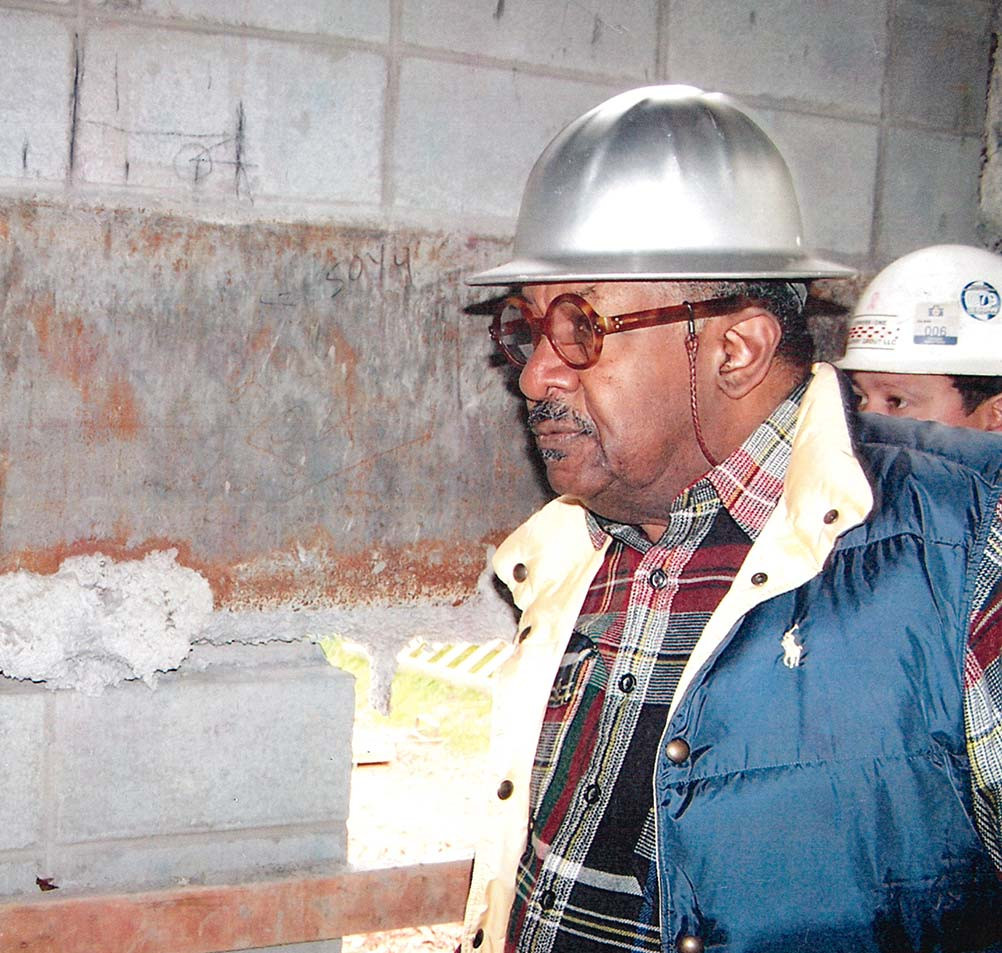 Stanley inspects a job site in 2015. (Courtesy of the architect)
