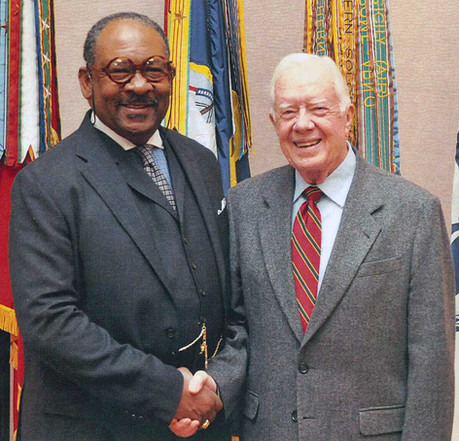 William Stanley, FAIA poses with former U.S. President Jimmy Carter. (Courtesy of the architect)