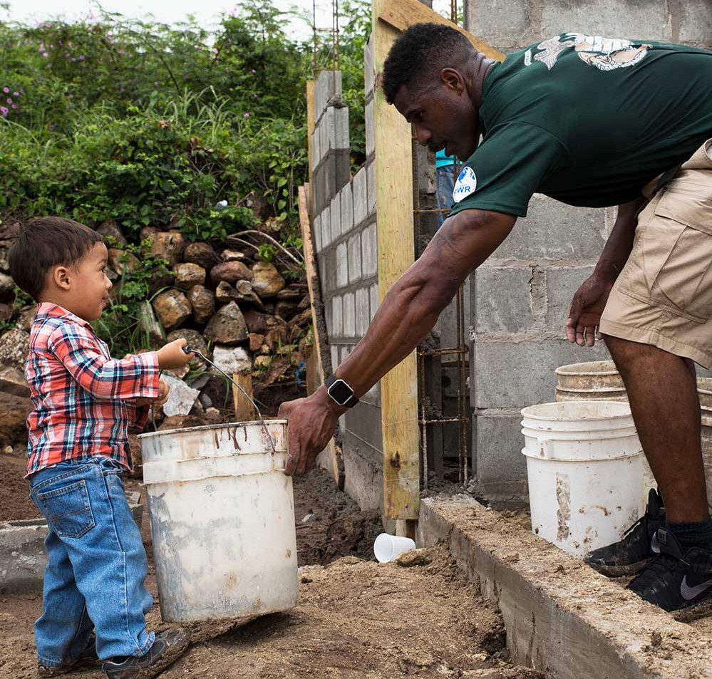 A Habitat for Humanity volunteer works with a village in Honduras, one of nearly 70 countries where the organization operates. (Melissa Martens/U.S. Dept. of Defense)