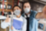 photo-of-students-in-medical-masks-takin