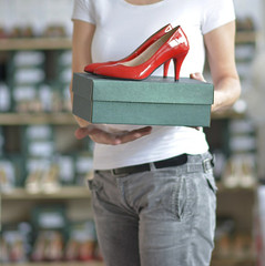 the-salesman-holds-a-box-with-red-ladies