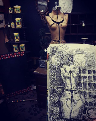 Sketching at the antique shop while othe