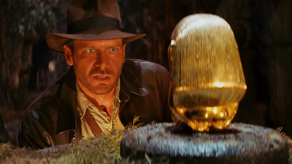Indiana Jones staring at the Fertility Idol