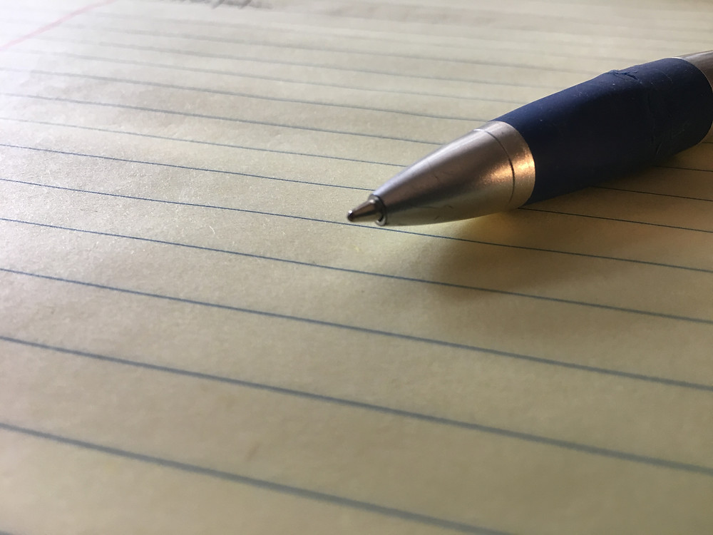 Pen and blank legal pad of paper