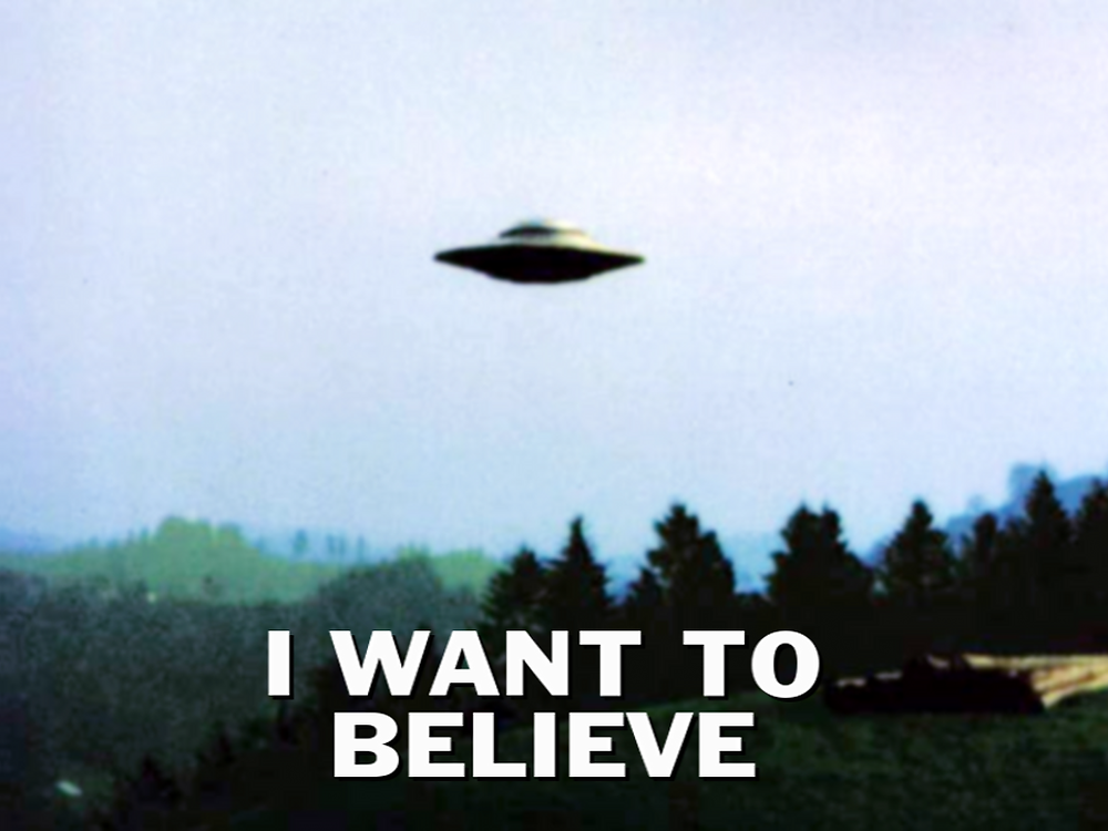 UFO floating with I Want to Believe below