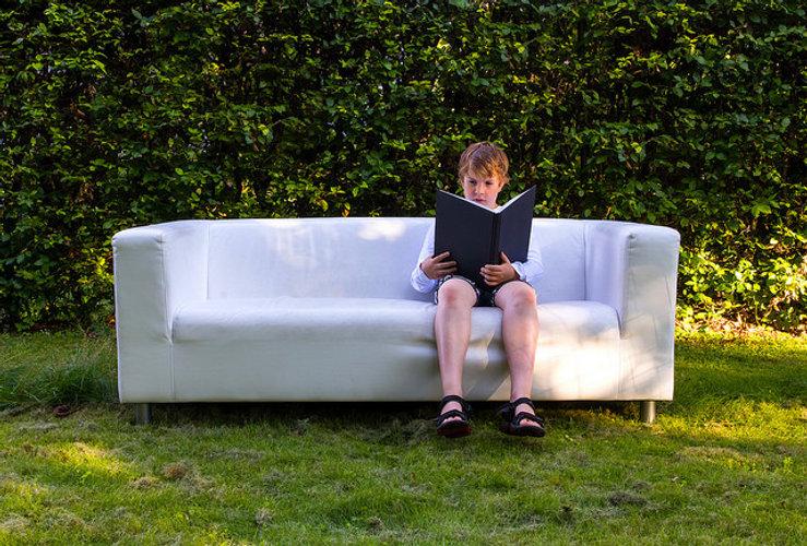 boy couch reading Niels Kliim CC by 2.0.