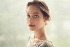 portrait of a beautiful girl on a backgr