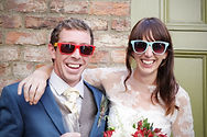 Jo and Chris Wright in matching sunglasses with big cheesy grins