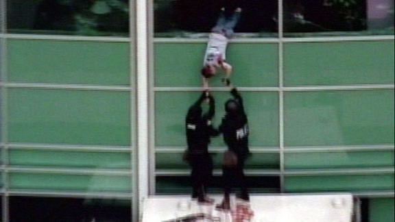 Patrick Ireland crawling out of a school room window