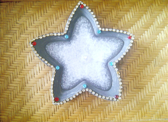 Star candle holder with candle