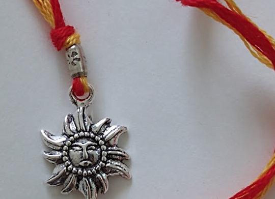 Sun Design Silver Rakhi