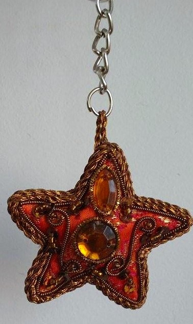 Zardosi work red star shaped key chain