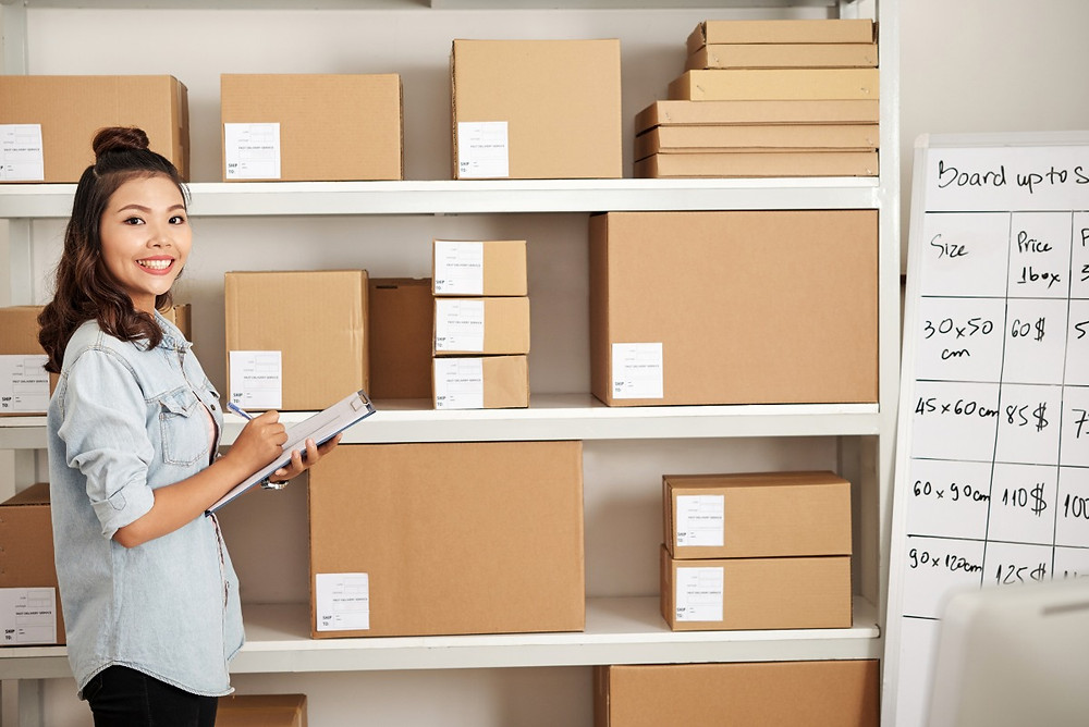 Woman in freight forwarder warehouse taking inventory