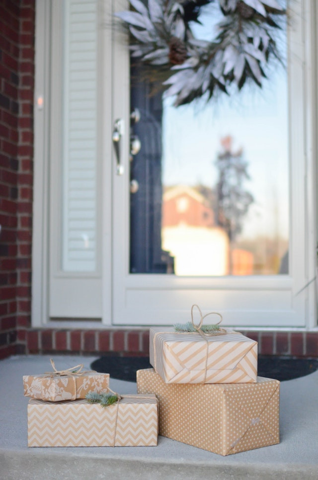 Christmas gifts delivered on the front porch of a home