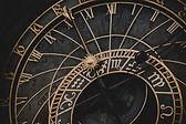 Black and Gold Roman Numeral Clock