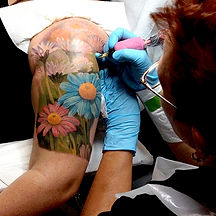 female tattoo artist, flower tattoo, color tattoo, tattoo sleeve, daisy tattoo, tattoo machine, tattoo session