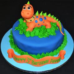 Orange dinosaur on round.JPG