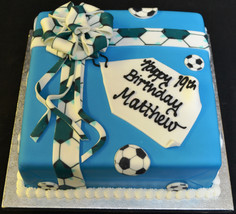 SQUARE PARCEL WITH FOOTBALL PRINT TRIM.J