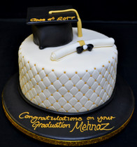 Quilted round with mortar board and scro