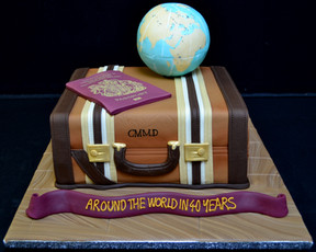 SUITCASE WITH GLOBE AND PASSPORT.JPG