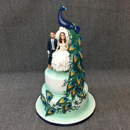Peacock wedding cake with models.JPG