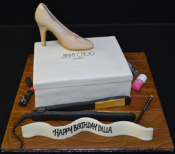 Jimmy Choos box with hair straighteners.