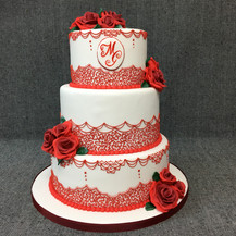 Wedding cake with roses and piping.JPG