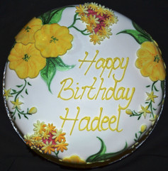 Round with hand painted flowers.JPG