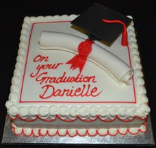 MORTAR BOARD AND SCROLL ON SQUARE.JPG