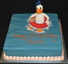 Square with Donald Duck in rubber ring.J