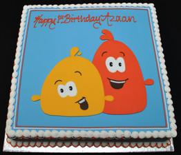 YELLOW AND ORANGE CHARACTER CAKE.JPG
