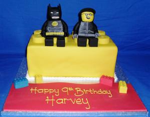 Batman and man lego on lego brick.jpg