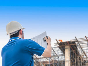 engineer-is-inspecting-his-work-building