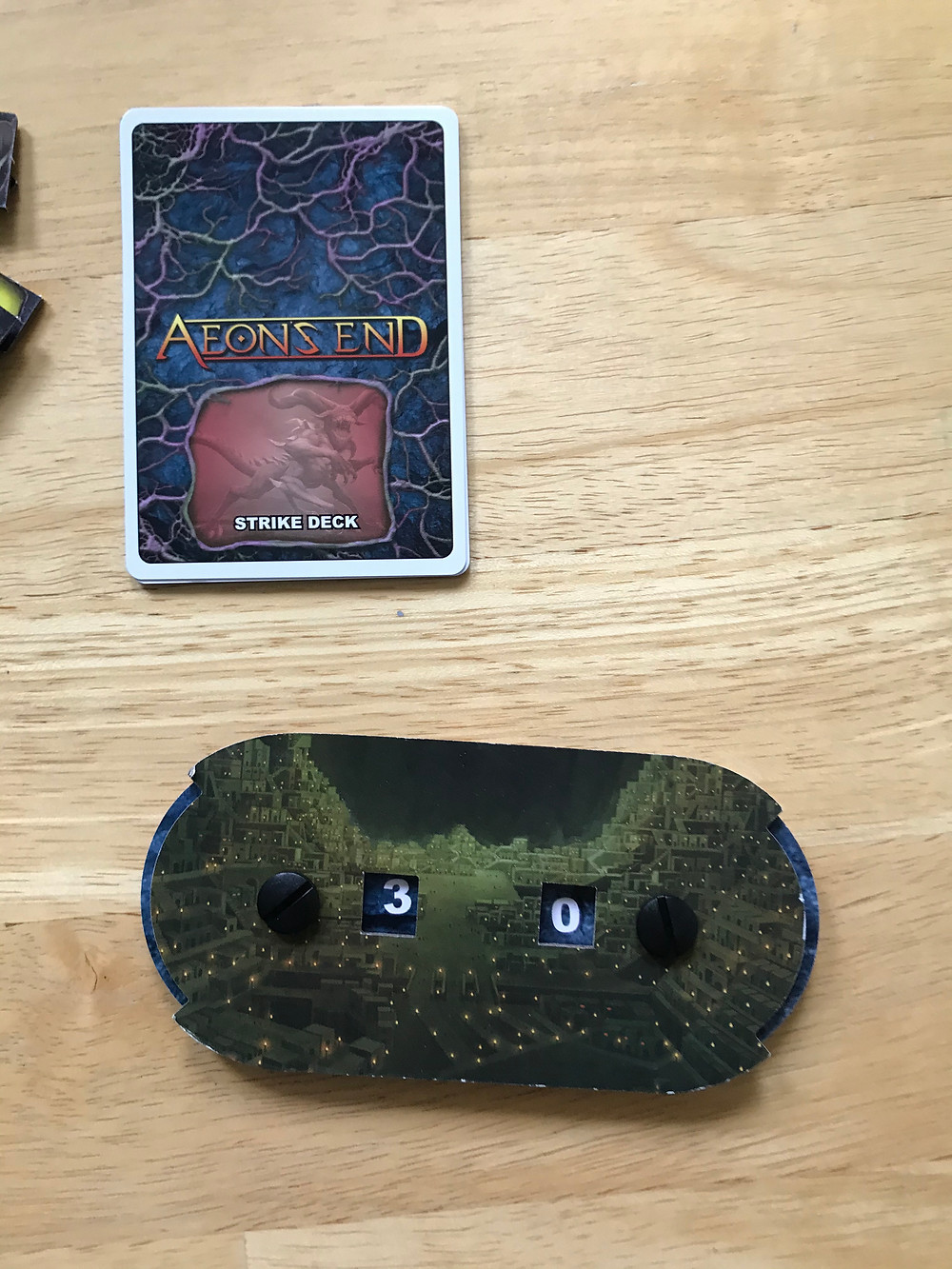 Aeon's End Rageborne strike deck and Gravehold life counter.