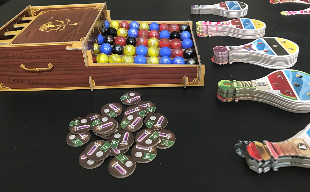"""These """"helper"""" tokens serve as a reminder that you paid 2 victory points to take an extra marble on your turn."""