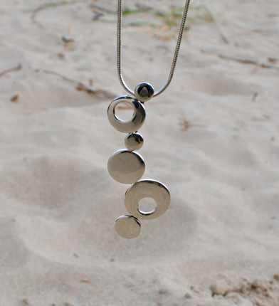 Rock Pools - A solid silver chain of connecting rock pools bring us back to all those seaside trips and exploring new universes in tiny pools.