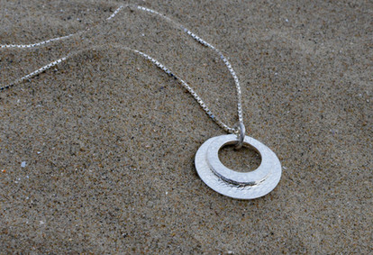 Orbiting Moons - Solid silver moons move independently of each other, yet are forever bound together.