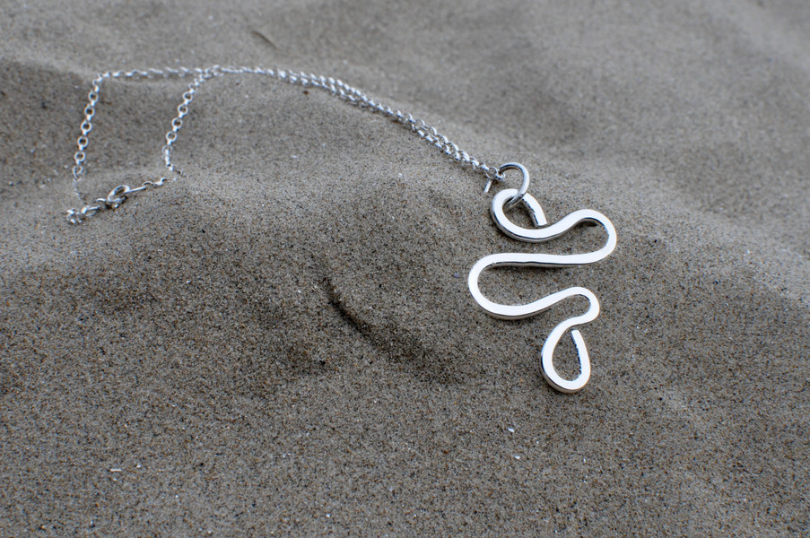 Wave of Moonlight- A solid silver wave inspired by Yeats' 'He Wishes for the Cloths of Heaven' captures the movement of the sea on the sand 'Where the wave of moonlight glosses The dim grey sands with light …'