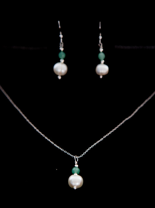 Cultured pearl with jade coloured crystals