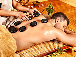 Man getting stone therapy massage in bam