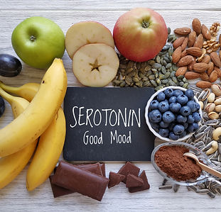 Serotonin-boosting foods. Assortment of
