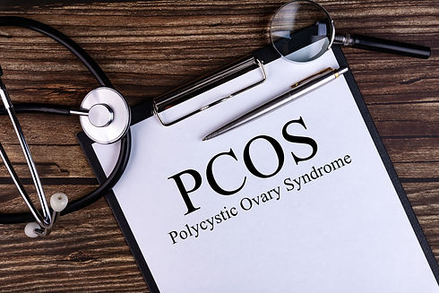 PCOS text is written on a tablet lying o