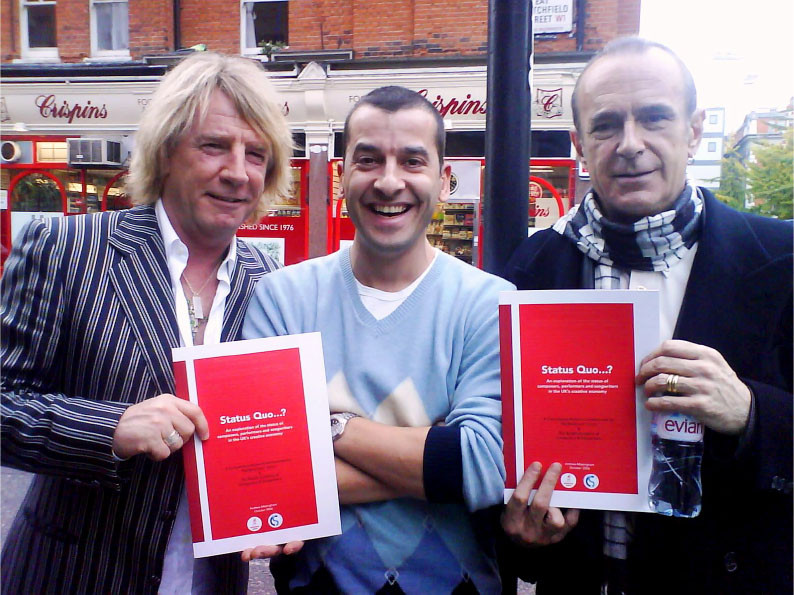 stalwarts of the British music scene and campaigners for the rights of performers Rick Parfitt [left] and Francis Rossi [right] flank Author Andrew Missingham, to promote the 'Status Quo' research booklet.